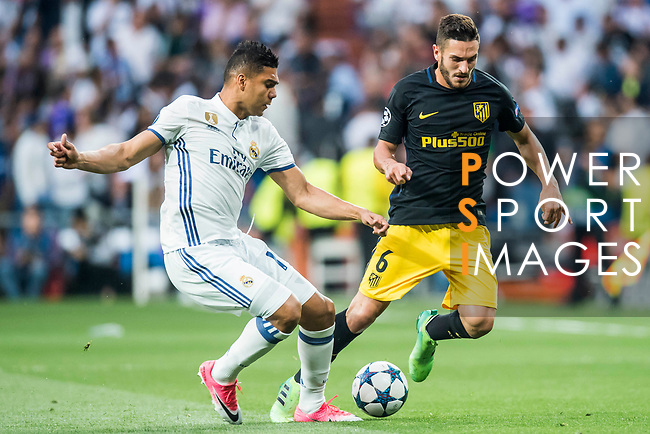 Jorge Resurreccion Merodio, Koke (r), of Atletico de Madrid competes for the ball with Carlos Henrique Casemiro of Real Madrid during their 2016-17 UEFA Champions League Semifinals 1st leg match between Real Madrid and Atletico de Madrid at the Estadio Santiago Bernabeu on 02 May 2017 in Madrid, Spain. Photo by Diego Gonzalez Souto / Power Sport Images