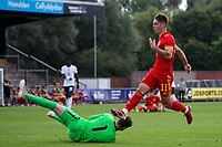 3rd September 2021; Newport, Wales:  Cian Ashfrod Wales jumps over goalkeeper Charlie Setford of England during the U18 International Friendly match between Wales and England at Newport Stadium in Newport, Wales.