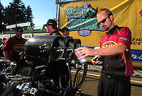 Aug. 7, 2011; Kent, WA, USA; NHRA top fuel dragster crew member for champion Del Worsham celebrates after winning the Northwest Nationals at Pacific Raceways. Mandatory Credit: Mark J. Rebilas-