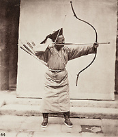 BNPS.co.uk (01202 558833)<br /> Pic: ForumAuctions/BNPS<br /> <br /> Pictured: An archer strikes a pose<br /> <br /> Rarely seen 150 year old photos taken by one of the first British photographers to explore China have emerged for sale for £20,000.<br /> <br /> Scotsman John Thomson (1837-1921) travelled to the Far East in 1868 and established a studio in Hong Kong, using it as a base to explore remote parts of the vast country for the next four years, photographing landmarks, scenery and the native population.<br /> <br /> In many cases, he was the first Westerner the people he photographed had encountered.<br /> <br /> One striking image shows a prisoner in chains with a head poking through a board covered in Chinese symbols, perhaps listing his misdemeanours. In another, a man poses next to a giant camel statue in the grounds around the Ming tombs of the Forbidden City.<br /> <br /> Almost 100 of his photos feature in a rare first edition of 'Thomson Illustrations of China and Its People' (1873), which is going under the hammer with London-based Forum Auctions.