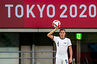 TOKYO, JAPAN - JULY 21: Kelley O'Hara #5 of the United States prepares to take a throw in during a game between Sweden and USWNT at Tokyo Stadium on July 21, 2021 in Tokyo, Japan.
