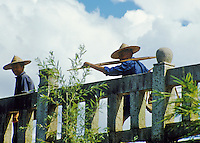Two farmers crossing a bridge in Guilin, China