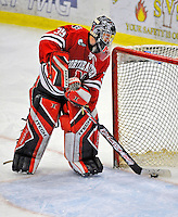 19 January 2008: Northeastern University Huskies' goaltender Brad Thiessen, a Sophomore from Aldergrove, British Columbia, scoops the puck out of the net after giving up the fouth goal of the night by the University of Vermont Catamounts at Gutterson Fieldhouse in Burlington, Vermont. The Catamounts defeated the Huskies 5-2 to close out their 2-game weekend series...Mandatory Photo Credit: Ed Wolfstein Photo