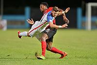 Couva, Trinidad & Tobago - Tuesday Oct. 10, 2017: Paul Arriola, Levi García during a 2018 FIFA World Cup Qualifier between the men's national teams of the United States (USA) and Trinidad & Tobago (TRI) at Ato Boldon Stadium.
