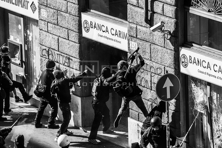 Rioters vandalize a bank entrance and ATM cash machines in via Cavour. Rome, Italy. 15 Oct.. 2011