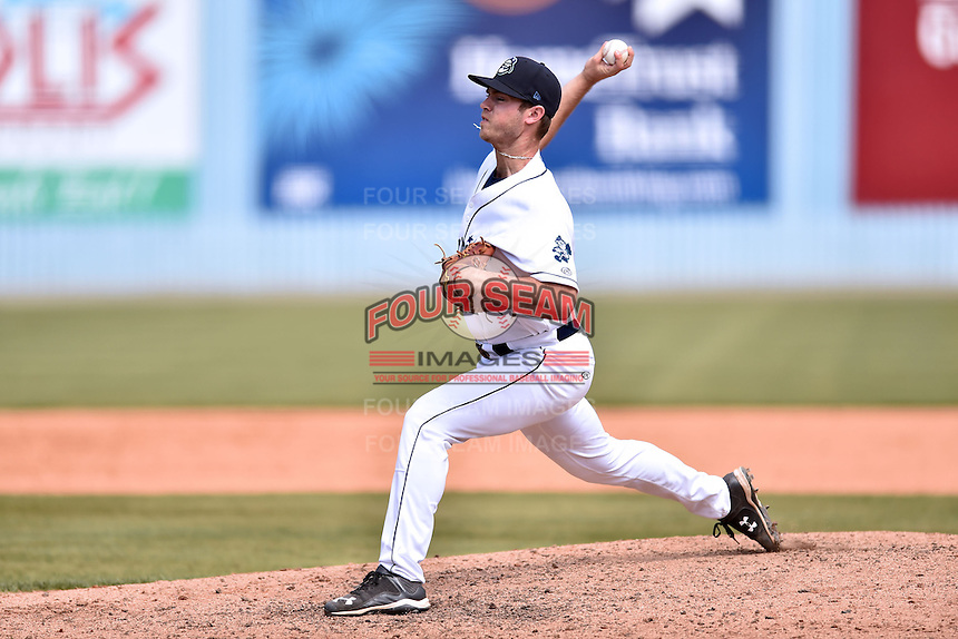 Asheville Tourists pitcher Blake Shouse (11) delivers a pitch during a game against the Lexington Legends on May 3, 2015 in Asheville, North Carolina. The Legends defeated the Tourists 6-3. (Tony Farlow/Four Seam Images)