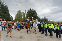 Pictured: Mounted police officers separate revellers and police officers. Monday 31 August 2020<br /> Re: Around 70 South Wales Police officers executed a dispersal order at the site of an illegal rave party, where they confiscated sound gear used by the organisers in woods near the village of Banwen, in south Wales, UK.