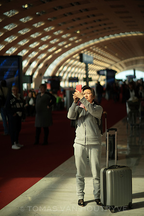 An air traveler uses a mobile phone to take a picture in Terminal 2E in the Charles de Gaulle airport in Paris, France.