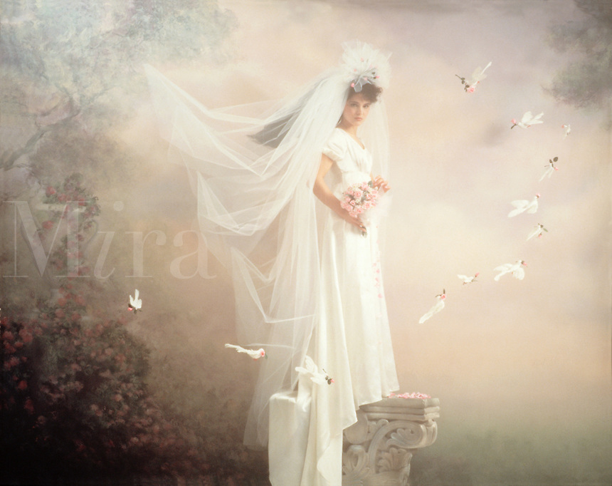 Fantasy Series - A bride on a pedestal, surrounded by a ring of white doves and a bower of flowers.