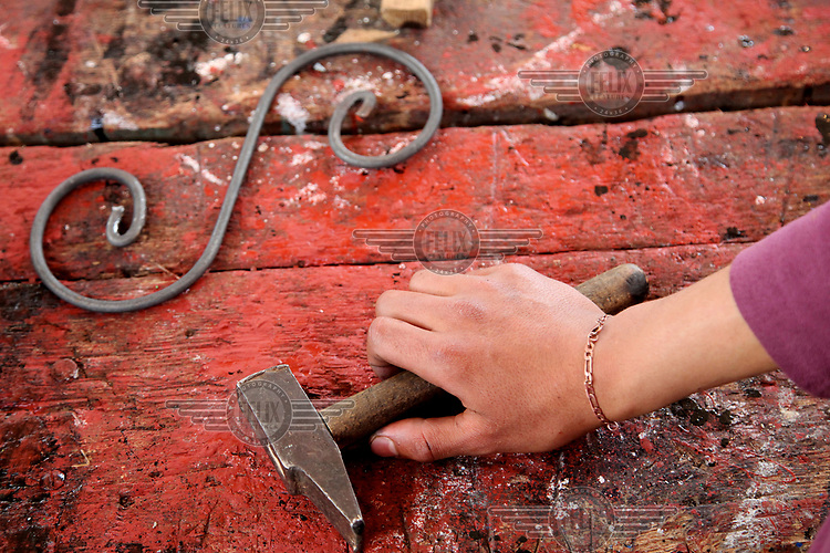 A youth uses tools in a metalwork class at the Center Abdelaziz Ben Driss which works with youths who have been in trouble with the authorities.