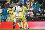 Gareth Bale (C) of Real Madrid is tackled by Daniele Bonera (R) of Villarreal CF during the La Liga 2017-18 match between Real Madrid and Villarreal CF at Santiago Bernabeu Stadium on January 13 2018 in Madrid, Spain. Photo by Diego Gonzalez / Power Sport Images