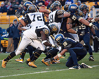WVU running back Ryan Clarke scores on a 2-yard touchdown run. The WVU Mountaineers defeated the Pitt Panthers 35-10 at Heinz Field, Pittsburgh, Pennsylvania on November 26, 2010.