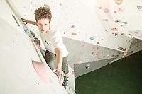 Climber at an indoor climbing wall.