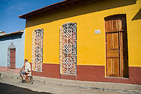 Cyclists in the streets of Trinidad, Sancti Spiritus, Cuba.