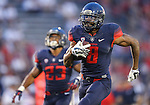 Arizona quarterback Jerrard Randall (8) rushes for a 57-yard touchdown against Nevada during the second half of an NCAA college football game in Reno, Nev., on Saturday, Sept. 12, 2015. (AP Photo/Cathleen Allison)