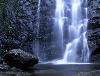 Boulder and waterfall, Palolo valley.