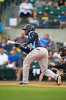 Corpus Christi Hooks outfielder Teoscar Hernandez (15) squares to bunt during a game against the Arkansas Travelers on May 29, 2015 at Dickey-Stephens Park in Little Rock, Arkansas.  Corpus Christi defeated Arkansas 4-0 in a rain shortened game.  (Mike Janes/Four Seam Images)