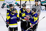 Verity Skater #12 Leo Kan (c) celebrates with teammates after scoring during the Principal Standard League match between Medical Winner Kings vs Verity at the Mega Ice on 17 January 2017 in Hong Kong, China. Photo by Marcio Rodrigo Machado / Power Sport Images