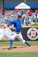 Buddy Baumann (13) of the Omaha Storm Chasers delivers a pitch to the plate against the Memphis Redbirds in Pacific Coast League action at Werner Park on April 22, 2015 in Papillion, Nebraska.  (Stephen Smith/Four Seam Images)