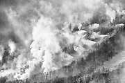 Black & white of snow making at Cannon Mountain in Franconia Notch State Park of the New Hampshire White Mountains. This view is from from Artists Bluff.
