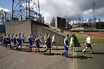 Edinburgh City 1 Cove Rangers 1, 30/04/2016. Commonwealth Stadium, Scottish League Pyramid Play Off. The teams walking on to the pitch before the Scottish pyramid play-off second leg between Edinburgh City (in white) and Cove Rangers at the Commonwealth Stadium at Meadowbank in Edinburgh. The match between the champions of the Lowland and Highland Leagues determined which club would play-off against East Stirlingshire for a place in the Scottish league. The second leg ended 1-1, giving Edinburgh City a 4-1 aggregate win. Photo by Colin McPherson.