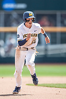 Michigan Wolverines third baseman Blake Nelson (10) runs to third base during Game 11 of the NCAA College World Series against the Texas Tech Red Raiders on June 21, 2019 at TD Ameritrade Park in Omaha, Nebraska. Michigan defeated Texas Tech 15-3 and is headed to the CWS Finals. (Andrew Woolley/Four Seam Images)