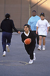 Asian 4th form girl learning Rugby football skills. Secondary School 1990s UK. Greenford High School, Middlesex  London 1990 UK