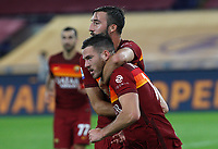 Roma s Jordan Veretout, foreground, is congratulated by his teammate Bryan Cristante after scoring on a penalty kick during the Serie A soccer match between Roma and Benevento at Rome's Olympic Stadium, October 18, 2020.<br /> UPDATE IMAGES PRESS/Riccardo De Luca