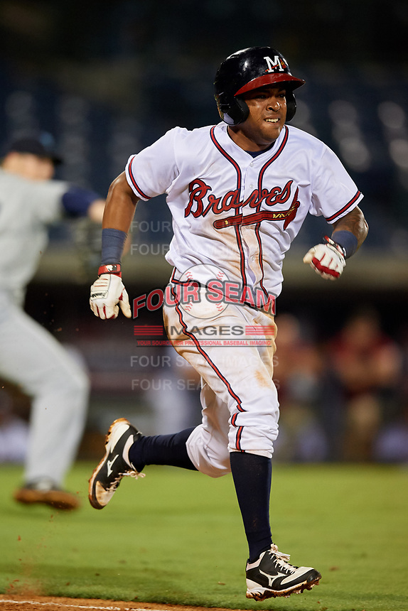 Mississippi Braves shortstop Luis Valenzuela (1) runs to first base during a game against the Mobile BayBears on May 7, 2018 at Trustmark park in Pearl, Mississippi.  Mobile defeated Mississippi 5-0.  (Mike Janes/Four Seam Images)