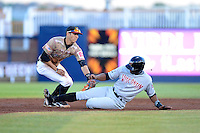 Quad Cities River Bandits shortstop Carlos Correa #1 tags out Victor Roache sliding in on a stolen base attempt during a game against the Wisconsin Timber Rattlers on May 24, 2013 at Modern Woodmen Park in Davenport, Iowa.  Quad Cities defeated Wisconsin 4-3  (Mike Janes/Four Seam Images)