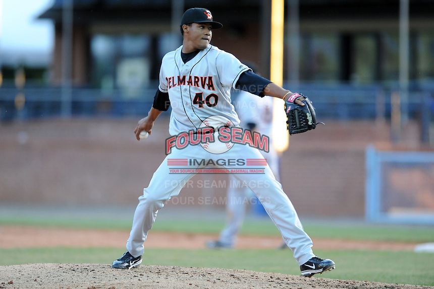 Delmarva Shorebirds pitcher Jose Nivar #40 delivers at a pitch  during a game between the Delmarva Shorebirds and the Asheville Tourists at McCormick Field, Asheville, North Carolina April 7, 2012. The Tourists won game one of a double header  8-4  (Tony Farlow/Four Seam Images)..