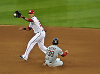 11 October 2012: Washington Nationals shortstop Ian Desmond gets Pete Kozma out at second during Postseason Playoff Game 4 of the National League Divisional Series against the St. Louis Cardinals at Nationals Park in Washington, DC. The Nationals defeated the Cardinals 2-1 on a 9th inning, walk-off solo home run by Jayson Werth, tying the Series at 2 games apiece. Mandatory Credit: Ed Wolfstein Photo