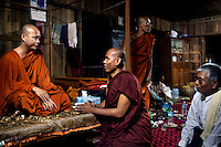 U Wirathu, the spiritual leader of the Buddhist nationalist 969 Movement, talks with other monks and a layman before going on stage after travelling to give a sermon at the Shwe Areleain Monastery in Kyaw Min Village, Myiamu Township. U Wirathu is an abbot in the New Maesoeyin Monastery where he leads about 60 monks and has influence over more than 2,500 residing there. He travels the country giving sermons to religious and laypeople encouraging Buddhists to shun Muslim business and communities. /Felix Features