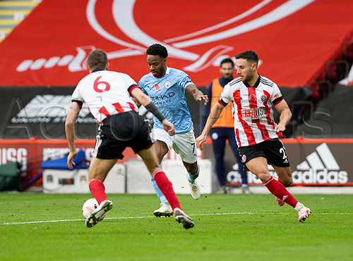 31st October 2020; Bramall Lane, Sheffield, Yorkshire, England; English Premier League Football, Sheffield United versus Manchester City; Raheem Sterling of Manchester City breaks forward with the ball past Ethan Ampadu and Chris Basham of Sheffield United