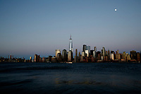 JERSEY CITY - NEW JERSEY - MARCH 26: The One World Trade Center and lower Manhattan are seen during a sunset on March 26, 2021 as seen from Jersey City. New York's tourism and its industries have been struck hard by the Covid-19 pandemic, with no more than 33% of people visited NYC in 2020, compared with 66 million in 2019, now the big apple hopes to welcome more than 36 million during year.(Photo by Emaz/VIEWpress)