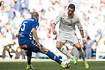 Cristiano Ronaldo (r) of Real Madrid is challenged by Victor Laguardia Cisneros of Deportivo Alaves during their La Liga match between Real Madrid and Deportivo Alaves at the Santiago Bernabeu Stadium on 02 April 2017 in Madrid, Spain. Photo by Diego Gonzalez Souto / Power Sport Images