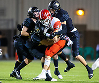 Kyler Carmack (3) of  Cabot is brought down by a host of Tigers  at Tiger Stadium, Bentonville, Arkansas on Friday, November 20, 2020 / Special to NWA Democrat-Gazette/ David Beach