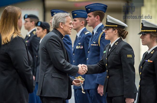 April 19, 2018; Notre Dame President Rev. John Jenkins, C.S.C. presents awards to ROTC cadets and midshipmen during the annual Pass-in-Review ceremonies. (Photo by Barbara Johnston/University of Notre Dame)