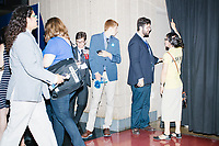 People wait near entrances to the mezzanine level seating area in advance of Vice President Joe Biden's speech at the Democratic National Convention at the Wells Fargo Center in Philadelphia, Pennsylvania, on Wed., July 27, 2016.  Seats filled up early in the night and many attendees had difficulty entering the arena to view the night's activities.