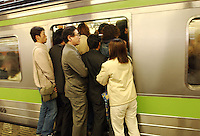 03/2002:  TRANSPORT: SHINJUJU STATION: TOKYO<br /> Comuters during rush hour in Shinjuku Station squeeze into packed trains.  Shinjuku is the busiest station in the world.<br /> photo by Richard Jones/sinopix<br /> ©sinopix