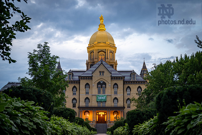 """August 2, 2020; Main Building with """"Here"""" campaign sign, 2020 (Photo by Matt Cashore/University of Notre Dame)"""