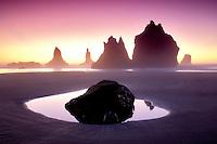 Monolith sea stacks reflecting pool and sunset. Samuel H. Boardman State Scenic Corridor. Oregon