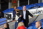 FIFA 2014 World Cup Qualifying Match - Wales v Macedonia at the Cardiff City Stadium : Neville Southall the former Wales goalkeeper takes a seat to watch the game.