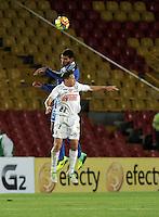 BOGOTA- COLOMBIA -19 -02-2014: Oswaldo Hnriquez  (Der.) jugador de Millonarios disputa el balón con Patricio Perez (Izq.) jugador del Once Caldas durante partido de la sexta fecha de la Liga Postobon I 2014, jugado en el Nemesio Camacho El Campin de la ciudad de Bogota. / Oswaldo Hnriquez  (R) player of Millonarios Fe vies for the ball with Patricio Perez (L) player of Once Caldas during a match for the sixth date of the Liga Postobon I 2014 at the Nemesio Camacho El Campin Stadium in Bogota city. Photo: VizzorImage  / Luis Ramirez / Staff