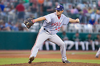 Hagerstown Suns relief pitcher Justin Thomas (45) delivers a pitch to the plate against the Greensboro Grasshoppers at NewBridge Bank Park on June 21, 2014 in Greensboro, North Carolina.  The Grasshoppers defeated the Suns 8-4. (Brian Westerholt/Four Seam Images)