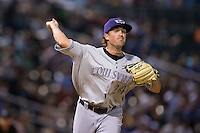 Louisville Bats relief pitcher Drew Hayes (24) makes a pick-off throw to first base against the Charlotte Knights at BB&T BallPark on May 12, 2015 in Charlotte, North Carolina.  The Knights defeated the Bats 4-0.  (Brian Westerholt/Four Seam Images)