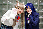 """Cosplayers pose for the picture during the Niconico Douga fan event at Makuhari Messe International Exhibition Hall on April 25, 2015, Chiba, Japan. The event includes special attractions such as J-pop concerts, Sumo and Pro Wrestling matches, cosplay and manga and various robot performances and is broadcast live on via the video-sharing site. Niconico Douga (in English """"Smiley, Smiley Video"""") is one of Japan's biggest video community sites where users can upload, view, share videos and write comments directly in real time, creating a sense of a shared watching. According to the organizers more than 200,000 viewers for two days will see the event by internet. The popular event is held in all 11 halls of the huge Makuhari Messe exhibition center from April 25 to 26. (Photo by Rodrigo Reyes Marin/AFLO)"""
