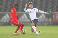 SWANSEA, WALES - NOVEMBER 12: Antonee Robinson #5 of the United States chases down a loose ball during a game between Wales and USMNT at Liberty Stadium on November 12, 2020 in Swansea, Wales.