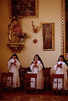 Nuns go to their chapel for chorus and pray seven times a day in a cloistered convent in Arequipa Peru. Contemplation is the most important thing in their lives. Santa Catalina Convent, the Monasterio de Santa Catalina, was built in 1580 and enlarged in the 17th century. Among the 30 nuns who live in privacy in the convent are five novicias who have to study for five years. The youngest nun is 15, the oldest is 98. They never leave the premises unless they have special permission to go to the doctor and to vote. The founder was supposed to have accepted girls from the finest of Spanish families. The nuns today take the traditional vow of poverty.