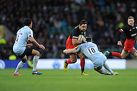 Brad Barritt of Saracens is tackled by Tom Heathcote of Worcester Warriors during the Premiership Rugby match between Saracens and Worcester Warriors - 28/11/2015 - Twickenham Stadium, London<br /> Mandatory Credit: Rob Munro/Stewart Communications